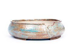 Ovalen pot Afmeting hxbxd 7 x 22,5 x 21 cm grove wit bakkende klei met beige glazuur en groenig/blauwe effecten steengoed gebakken op 1200 graden Celsius