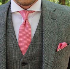Bright coral pinks paired with tweeds.