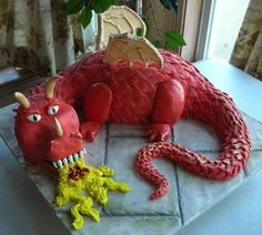 Dragon Cake with Fondant Scales: This was my sons birthday cake. I started by carving a hunk of chocolate cake into the shape of a dragon. Then I covered it with fondant scales. The wings