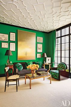 In the family room, emerald walls play off a textured ceiling.