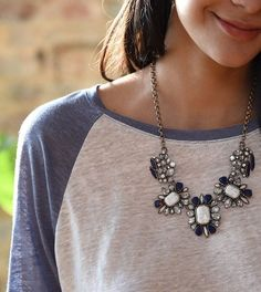 Fancy necklace with a baseball tee.