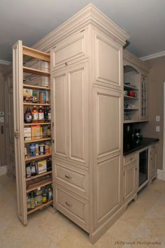 Love how the storage is optimized in this kitchen with the corner cabinetry and the tall pull-out pantry.