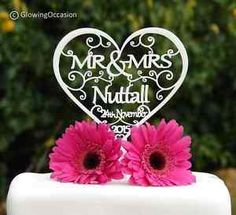 http://www.ebay.co.uk/itm/Personalised-Mr-Mrs-Wedding-Cake-Topper-With-Surname-and-Wedding-Date-/151663840457?_trksid=p2141725.m3641.l6368