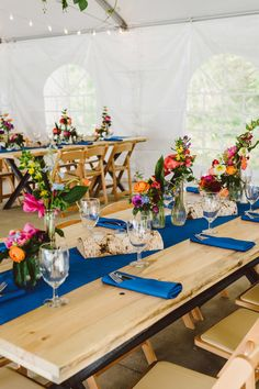 Royal blue + bright florals for a lakeside summer wedding