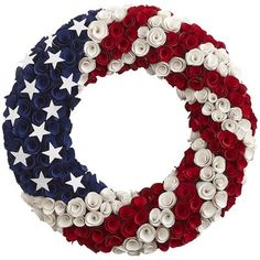 With more than a little patriotic panache, this wreath is handcrafted from natural poplar wood rosettes painted red, white and blue, then adorned with glittering white stars. Consider it an all-American salute for your front door.