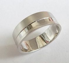 White gold wedding band men wedding ring gold ring with sandblast finish and off centered stripe Wedding Rings Simple, White Gold Wedding Bands, Custom Wedding Rings, Beautiful Wedding Rings, Unique Rings, Unique Wedding Bands For Him, Titanium Wedding Rings, Wedding Ring Bands, Groom Ring