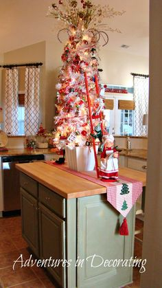 love everything about this tree and especially that its displayed on a kitchen island christmas