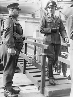 A Luftwaffe officer prisoner is escorted down the gangplank of a hospital ship to exercise on the quayside at Newhaven, 5 October 1941. He was one of a number of German POWs awaiting repatriation in a prisoner exchange.