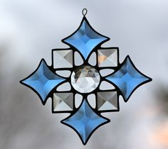 Stained glass bevel snowflake by Barbara's Glassworks.