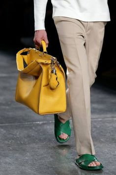 Fendi baby!  Love the bright yellow briefcase and green saddles....sweet!