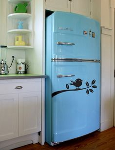 Vintage fridge  this blue is so lovely, i love the idea of having a mainly all white kitchen with these great pops of color via the appliances/decor