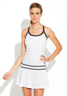 Collezione Pleated Dress Tank dress; Pleated dropped skirt; Scoop neck with contrast band detail; Double contrast stripe at waist; Shelf bra; Back features contrast racerback; FILA logo patch; Features SPF 30 protection; Not lined #Dress #Bra #Racerback