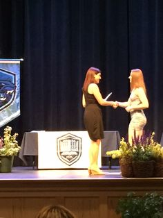 My daughter, Tammy, presenting a scholarship from The Kuney-Todaro Team of RE/MAX Executive Realty to Erin Hanley of the FHS graduating class in memory of Leanne Schmall, an FHS student who died of melanoma.