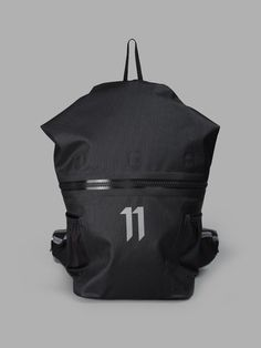 11 BY BORIS BIDJAN SABERI MEN'S BLACK BACKPACK   - BLACK - ZIP CLOSURE - SIDE POCKETS - 11 PRINT - ADJUSTABLE SHOULDER STRAPS - 100% NYLON - MADE IN GERMANY