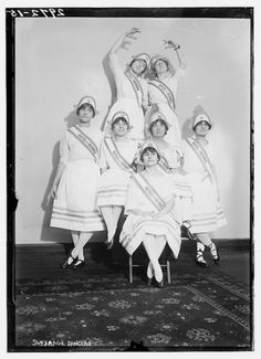 Old suffrage dancers. Matching outfits, banners.