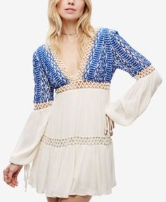 Free People Deep V-Neck Peasant Dress $87.99 Boho style looks fresh off the runway in this playful mini dress from Free People.
