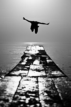 black white photography man diving off pier wharf into ocean, I so want this
