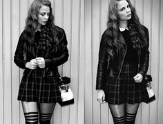 Plaid skirt Leather Jacket and sexy tights. Get this look: http://lb.nu/look/7737612  More looks by Katharina K.: http://lb.nu/ompipompi  Items in this look:  Zara Blouse, Zara Bag, H&M Leather Jacket   #artistic #edgy #grunge #germany #girls #munich #redhead #curls #fifties