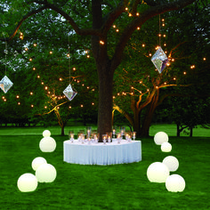 How magical to marry by moonlight (with a little low-wattage help). Hang decorative metallic pinatas from tree branches festooned with twinkly lights, and flank the aisle with glowing orbs for an out-of-this-world aura.  I love it!!