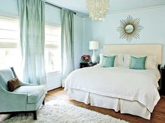 Cool soft blue bedroom design. I love the touches of cream and gold