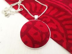 Scandinavian silver tone pendant with red repurposed Marimekko