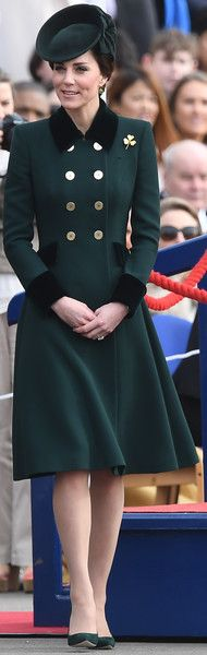 Kate Middleton Photos Photos - Britain's Catherine, Duchess of Cambridge visits the Irish Guards during a St Patrick's Day parade at Cavalry Barracks in Hounslow, west London on March 17, 2017. / AFP PHOTO / Justin TALLIS - The Duke And Duchess Of Cambridge Attend The Irish Guards St Patrick's Day Parade