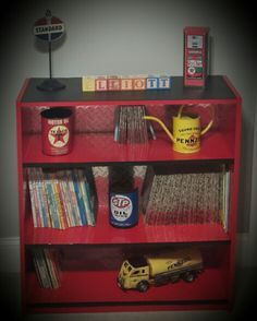 Elliott's Nursery. Vintage garage theme. Diamond plate bookshelf.