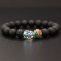 It's all about transformation. This unique onyx bracelet showcases a stunning Swarovski crystal skull. Flanked by a blue emperor jasper bead and matte and polished black onyx bead, the skull captures a kaleidoscope of color for a look that catches the eye from anywhere in the room.<br> <ul> <li>The skull symbolizes personal transformation</li> <li>Wearing this bracelet will go a long way to increasing your self-confidence</li> <li>Th...