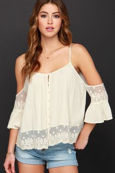 You'll be so pleased to meet the sweet and charming Howdy-Do Cream Lace Top! Crinkly woven fabric swings from spaghetti straps down into a wide-cut bodice with full button placket above a band of flirty sheer lace. The dramatic cold-shoulder cutouts make way for more lace and belling sleeves. Unlined. 100% Rayon. Hand Wash Cold. Imported.