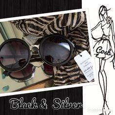 Black Round Sunglasses w/Silver Large round sunglasses with silver nose piece & trimmed in silver. Glasses have all black arms & have UVA protection. Cosb Accessories Glasses
