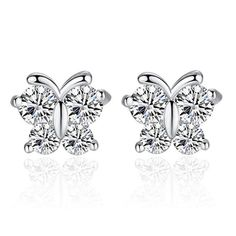 - Material: Sterling Silver - Stones: Clear CZ Stones - Earring Height: 8 mm - Type of Backs: Butterfly Backs