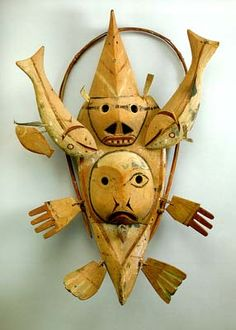 Artic Yup'ik Eskimo mask  early 1900's  wood, pigment, feathers  33 7/8 x 23 1/2 in.