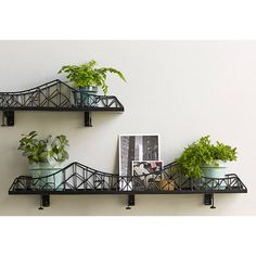 Iron bridge shelf unit. Less expensive than PB one. Neat for putting cars on. Would have to find for much, much less.