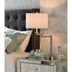 This trim swing arm desk lamp design offers a sleek, visually interesting look.