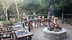 Boma fire burning at River Camp Sibuya Game Reserve guests experience a South… South African Braai, South Afrika, River Camp, Camping Places, Game Reserve, How To Make Bed, How To Level Ground, Places To Visit, Restaurant