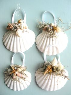 Tiny shells and moss with pearls. Ribbon hanger..must  Google Image Result for http://passport2design.com/wp-content/uploads/2010/11/set-of-4-white-scallop-shells-beachcottagegrass-on-etsy.com_.jpg
