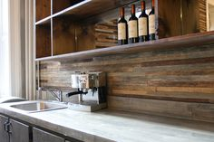 Back splash made from reclaimed wood. Love the contrast created by the rustic wood and modern counter tops and appliances.