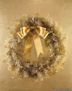 Wreath made from golden beads and thread.  It looks like Christmas tree lights almost.
