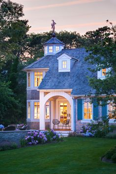 Great house--hydrangeas--and Janus et Cie chairs on porch!