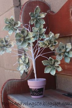 money tree gift -- made with origami flowers made of dollar bills!