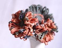 Traditional Yarn flowers with a new twist and texture.