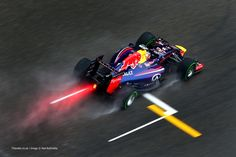 Germany's Sebastian Vettel of Infiniti Red Bull Racing leaves a trail during qualifying for the Chinese Formula One Grand Prix in Shanghai. Red Bull F1, Red Bull Racing, Real Racing, Racing Team, Auto Racing, Motogp, Car Wallpapers, Hd Wallpaper, Mclaren Formula 1
