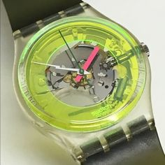 Vintage Swatch Watch 1985 Vintage Swatch Watch from 1985 is running and keeping perfect time with an included battery. Watch is in fantastic condition.  Original green jelly bands.  Protective storage case and paper included.  34mm diameter. Swatch Jewelry