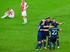 Manchester United's Armenian midfielder Henrikh Mkhitaryan celebrates with teammates after the UEFA Europa League final football match Ajax Amsterdam...