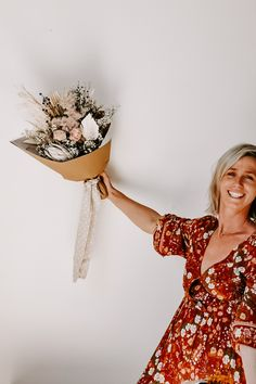 NEW BOUQUETS ... Our talented Florist Nat has been back in store working her magic on an incredible collection of new bouquet designs. This beauty is called 'Stardust' and it is loaded with delicious dried blooms including proteas, ming fern, palms and peonies. View them in store or online whilst stocks last. Dried Flowers, Peonies, Grass, Wrap Dress, Interior Decorating, Bouquet, Bloom, The Incredibles, Beauty
