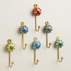 Hand painted in a variation of vibrant designs, our set of six Painted Ceramic Hooks coordinate to create a colorful, eclectic look. Crafted of ceramic and fashioned with an easy-to-hang mount, these hooks come at a delightful value. Paper Crafts For Kids, Diy Home Crafts, Wood Crafts, Arts And Crafts, Eclectic Wall Hooks, Wall Key Holder, Key Holders, Pine Cone Crafts, Blue Pottery