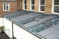 Looking to do this as a replacement roof for an existing conservatory in Mortlake panels of Sarnafil and insulation alternating with existing glazing which will be replaced with triple glazed to improve thermal efficiancy Flat Roof Systems from Climax