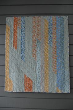 jelly roll race quilt inspiration - love the diagonal quilting