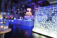 For the after-party, Iceculture created an eight-foot ice wall at the entrance of the trading floor. Iconic shapes from Karim...
