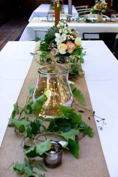 Naomi Rose Floral Design {Melbourne wedding} burlap table runner, lanterns, candles, trailing vine, copper fairy lights, flowers